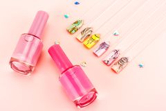 Nail designs on tips. Nail designs on tips and manicure set on a pink background stock photos