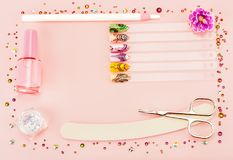 Nail designs on tips. Nail designs on tips and manicure set on a pink background. Photo with free space for text royalty free stock photos