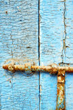 Nail dirty stripped paint in the blue wood door Royalty Free Stock Photos