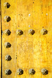 nail dirty stripped paint in the  wood  usty yellow red Royalty Free Stock Photos