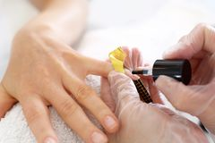 Nail extension with gel. Treatment hand and nail care, the woman to a beautician for a manicure stock photo