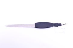 Nail file with a cuticle trimmer Royalty Free Stock Images