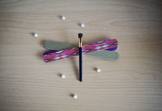 Nail files eyeshadow brush dragonfly shape and pearls Royalty Free Stock Image
