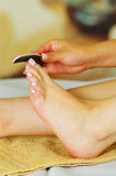 Nail files,foot care. Womanpedicure. Royalty Free Stock Photos