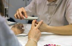 Nail filing manicurist closeup Royalty Free Stock Photo