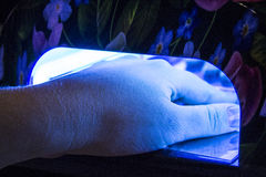 Nail gel salon. UV lamp. Nail gel salon. beautiful UV lamp with flowers Stock Photography
