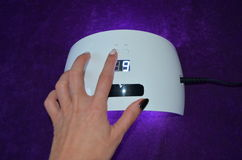 Nail gel salon. UV lamp with timer Royalty Free Stock Photography