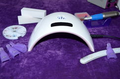 Nail gel salon. UV lamp with timer Stock Photo