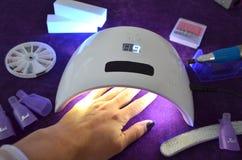 Nail gel salon. UV lamp with timer Stock Photos