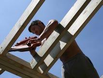 Nail Gun. A construction worker uses a nail gun stock photo