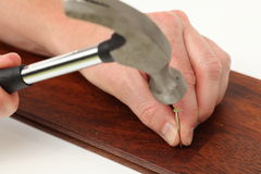 Nail and hammer Stock Photos