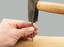 Nail and hammer Royalty Free Stock Photography