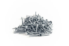 Nail heap. Pile of chromed small nails stock photo