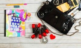 nail make-up Notebook Bag mirror woman lady stuff Royalty Free Stock Photo