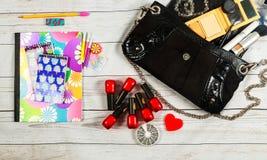 Nail make-up Notebook Bag mirror woman lady stuff Royalty Free Stock Images