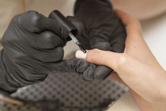 Free Nail Master In Rubber Gloves Apply Gel Polish Shellac On A Woman Royalty Free Stock Photography - 89527707