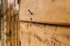 Nail on old wood wall Stock Photography