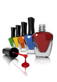 Nail Polish. Bottles arranged in a row with a dripping brush in the foreground Royalty Free Stock Photo