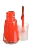 Nail polish. Red nail polish bottle isolated on white stock image