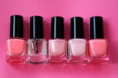 Nail Polish. Five bottles of nail polish over a pink background Stock Photography