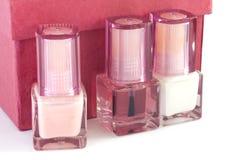 Nail polish 2. Three bottles of nail polish for French manicure Royalty Free Stock Photography
