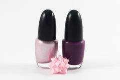 Nail polish. Pink and violet nail polish. Manicure concept.  on white Stock Images