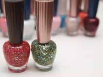 Nail polish. Two bottles of sparkling nail polish Royalty Free Stock Photography