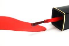 Nail polish. A leaking brush of red nail polish Royalty Free Stock Photos