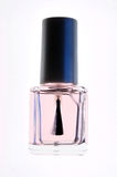 Nail polish. Transparent nail polish on a white background Stock Photography