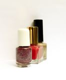 Nail polish. Three bottles of nail polish with shadows, on white Stock Photo