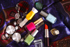 nail polish and accessory on silky scarf Royalty Free Stock Photos
