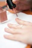 Nail polish action Royalty Free Stock Image