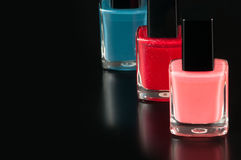 Nail polish. On a black background with reflections Stock Photo