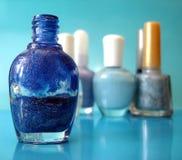 Nail polish on blue Royalty Free Stock Image