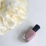 Nail Polish Bottle and Flower Royalty Free Stock Photos
