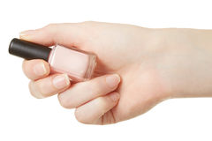 Nail polish bottle in woman hand stock images