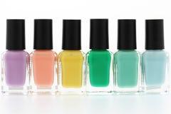 Nail polish bottles. Rainbow on white background Royalty Free Stock Photography
