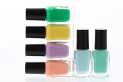 Nail polish bottles. Rainbow on white background Royalty Free Stock Images