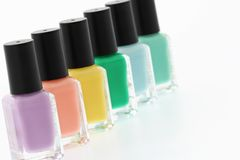 Nail polish bottles. Rainbow on white background Stock Images