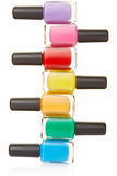 Nail polish bottles colorful stack Royalty Free Stock Photos