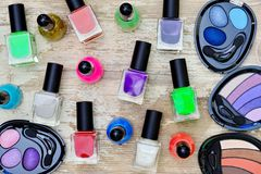 Nail polish bottles of different colors on white wooden table. Nail polish bottles of different colors on rustic white wooden table stock images