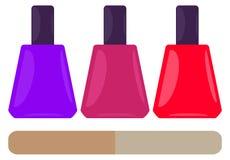 Nail polish bottles and nail file Royalty Free Stock Photography