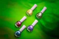 Nail polish. Bottles of nail polish on green background Stock Photography