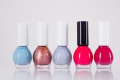 Nail polish bottles, manicure and pedicure collection. Beauty, make-up and cosmetics concept - Nail polish bottles, manicure and pedicure collection stock images