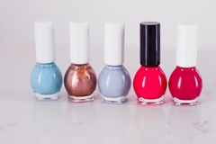Nail polish bottles, manicure and pedicure collection. Beauty, make-up and cosmetics concept - Nail polish bottles, manicure and pedicure collection royalty free stock images