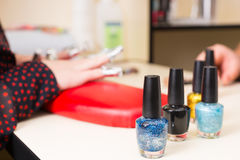 Nail Polish Bottles on Manicure Table Stock Images