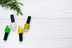Nail polish bottles natural green and yellow colors stock image