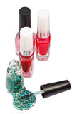 Nail polish bottles and spilled green lacquer Stock Photos