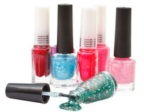 Nail polish bottles and spilled lacquer isolated Royalty Free Stock Image