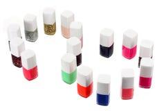 Nail Polish Bottles. On White Background royalty free stock image